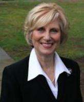 Beth Briggs , Executive Director