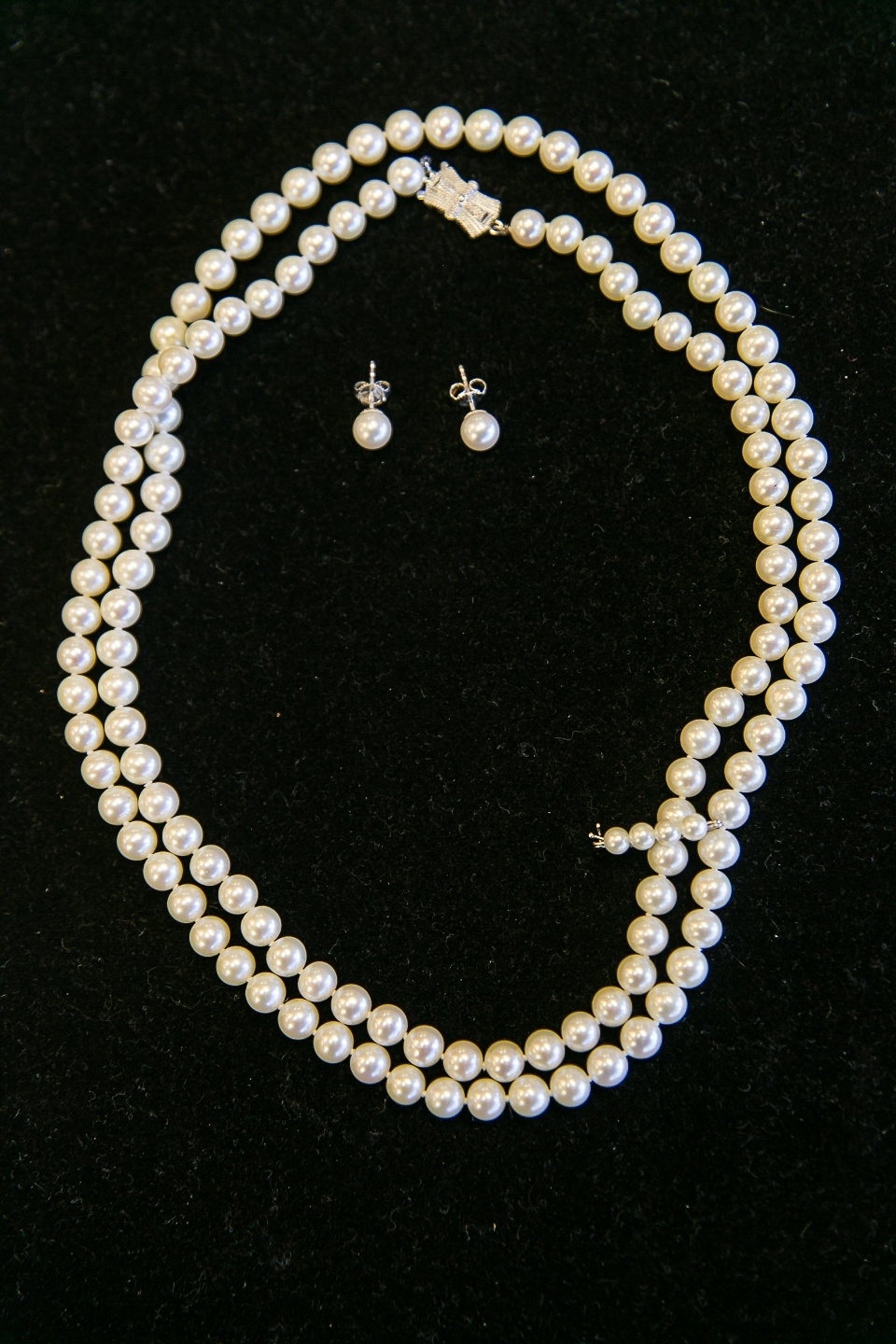 Mikmoto Pearls   30-inch double strand of Mikimoto pearls with a 14-karat white gold clasp.    Bonus in this purchase is a pair of 6.5-7.0 mm high quality pearl stud earrings.   Suggested retail is $1695.00   SOLD!