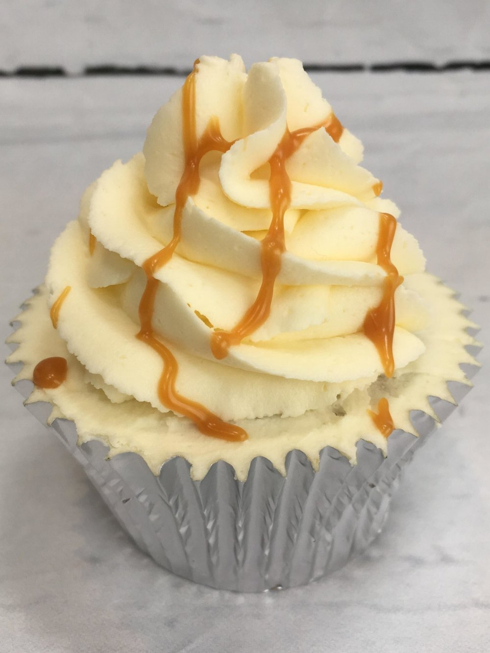 Salted Caramel - A caramel cupcake filled with salted caramel sauce and topped with decadent salted caramel buttercream