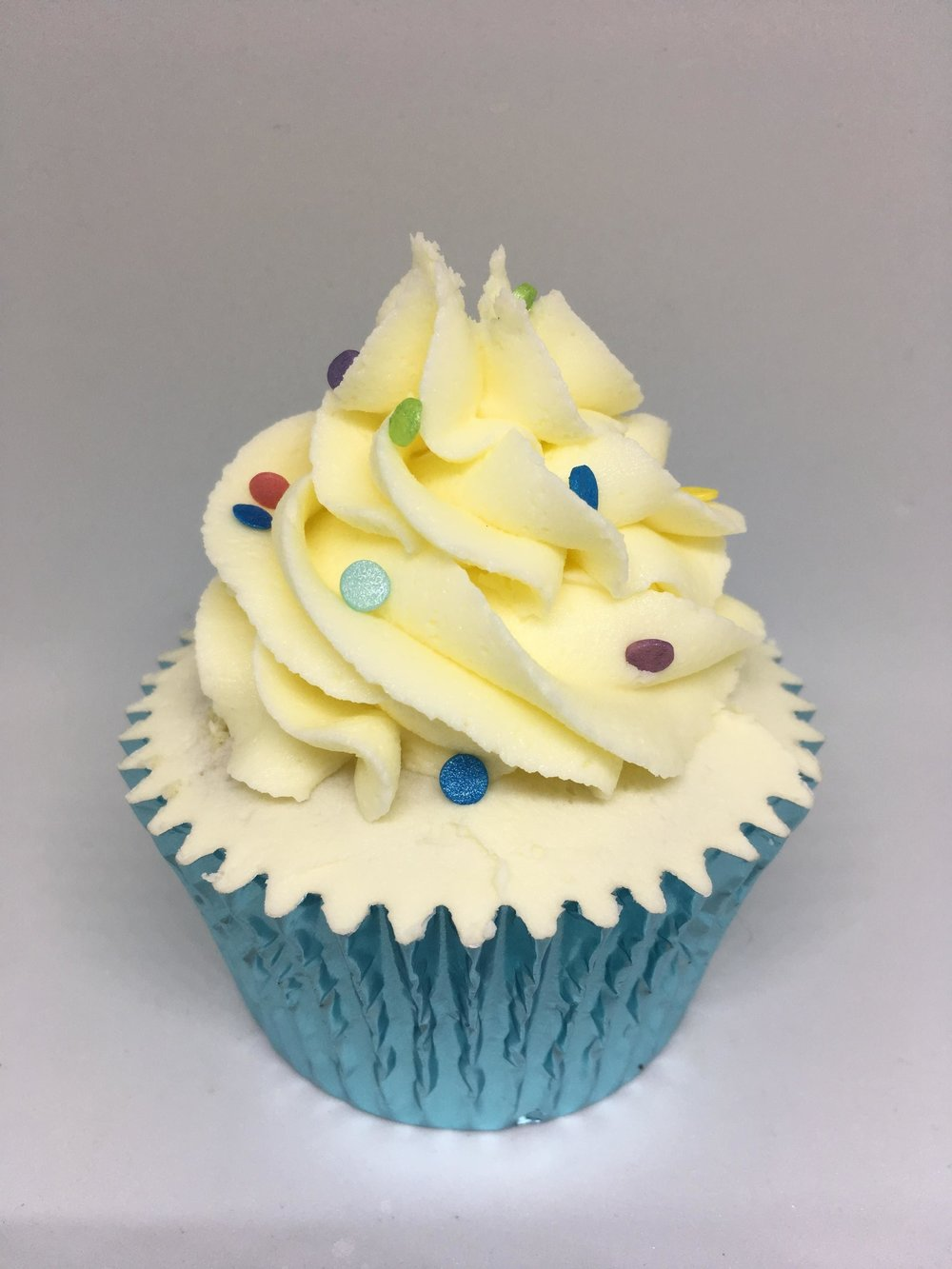 Classic Vanilla - A Rock the Bake vanilla cupcake topped with fluffy vanilla buttercream. Simple and Calssic but so good