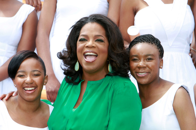 Oprah Winfrey with graduates of the Oprah Winfrey Leadership Academy for Girls on January 14, 2012, in South Africa. Michelly Rall/Getty Images.