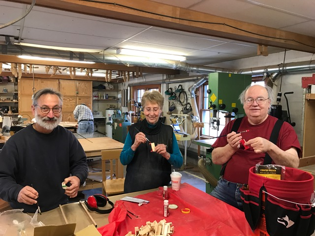 Here are our Toymaker guild members constructing swan boats for sale.