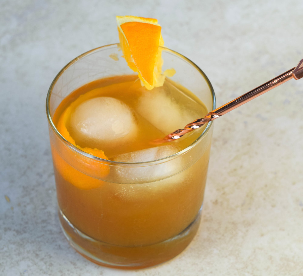 Maple Bourbon Blossom - Ingredients: 1/2 oz Maple Syrup, 1/2 oz fresh orange juice, 1/4 oz fresh lemon juice, 4 dashes of bitters, 2 oz of Bourbon, ice, 1.5 oz of seltzerDirections: Combine the maple syrup with the orange juice, lemon juice and bitters in a tumbler or rock glass. Add the orange wheel and lightly muddle. Fill the glass with ice and top with chilled seltzer. Perfect for any season and any weather. Enjoy with good friends.