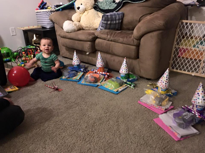 Wyatt helping his mom Lisa get some bday bags together for The Family Partnership kids.