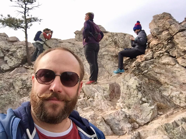 When not teaching at-risk youth, Ben can usually be found in the mountains of Colorado, or with cats.