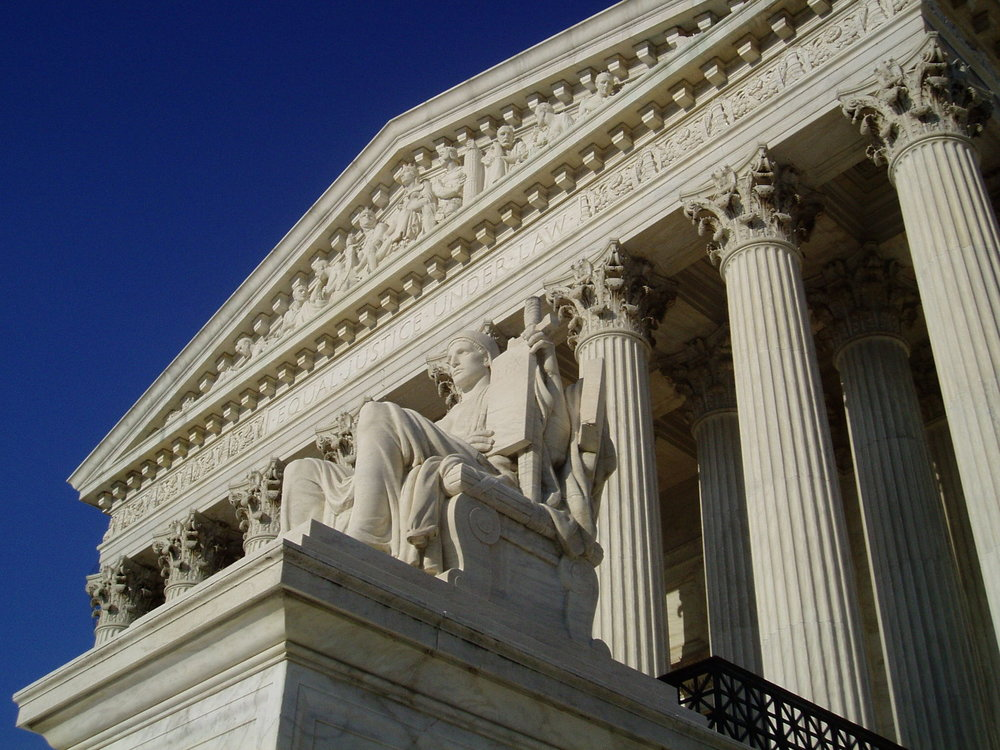 Photo by  Matt H. Wade ,  CC-BY-SA-3.0 , available at Wikimedia Commons, https://commons.wikimedia.org/wiki/Supreme_Court_of_the_United_States#/media/File:AuthorityOfLaw.JPG