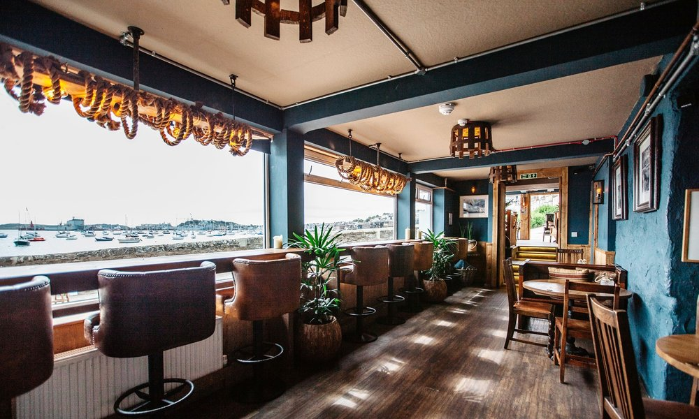 THE WORKING BOAT - Seas the day at this cosy quayside pub whilst admiring the views across Falmouth harbour. With an authentic atmosphere, moor up and cruise in for some proper pub grub. Established in 1876, rebuilt in 2015.01326 314283
