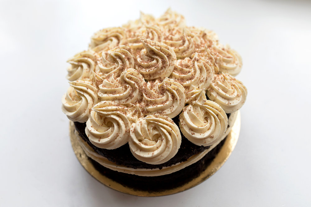 Chocolate Fudge cake - Chocolate fudge cake with a white chocolate toppin, serves up to 16 people and costs 32,50.