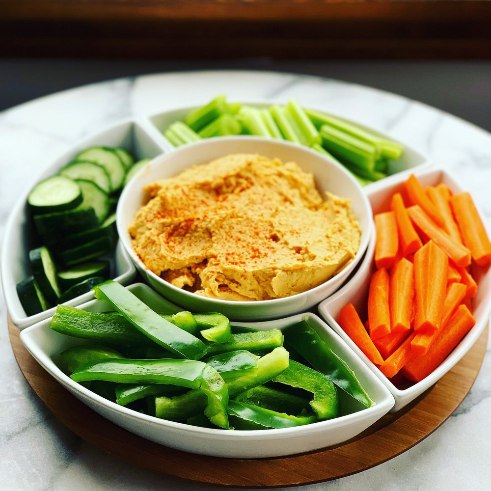 The recipe you never knew you needed. If you are a fan of delicious dips, this recipe is a must try. It is great for any event as a beautiful serving dish or to store in your fridge for quick, on-the-go pre-made snacks. Either way, this dip deserves a place in your fridge.   To make the dip, start by peeling 2 small sweet potatoes (or 1 large) and dicing into small squares. Steam the sweet potatoes until tender. Add into a food processor: steamed sweet potatoes, 1/4 cup tahini, the juice of 2 lemons, 3 cloves of garlic, 3 Tbsp olive oil, 1 can chick peas (rinsed and drained), 1 tsp paprika, 1 tsp cumin, 1 tsp salt, and freshly ground black pepper. Blend all ingredients until well combined. Depending on your preferred consistency and taste, play around with ingredient amounts. If you like thick, chunky dips go lighter on the lemon juice and olive oil. If you like really smooth and creamy dips, add slightly more olive oil and a little less tahini. I'm a fan of bold flavor so I added extra lemon juice, salt, and paprika.   This dip is great served with veggies, crackers, or even as a sandwich spread. I hope you enjoy this recipe that doubles as a sneaky way to get another serving of vegetables into your day. It's so good you won't even know how good it is for you!