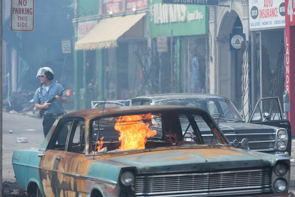 En av politimennene (Jack Reynor) som blir involvert i tragiske hendelser under opprøret i Detroit i juli 1967.