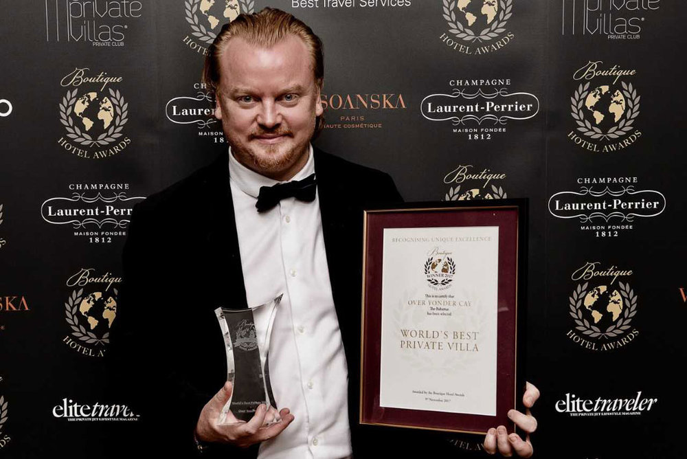 "Janus Kamradt, accepting Boutique Hotel Award for OYC as ""World's Best Private Villa"""