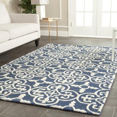 Wayfair has this navy medalian rug  here .