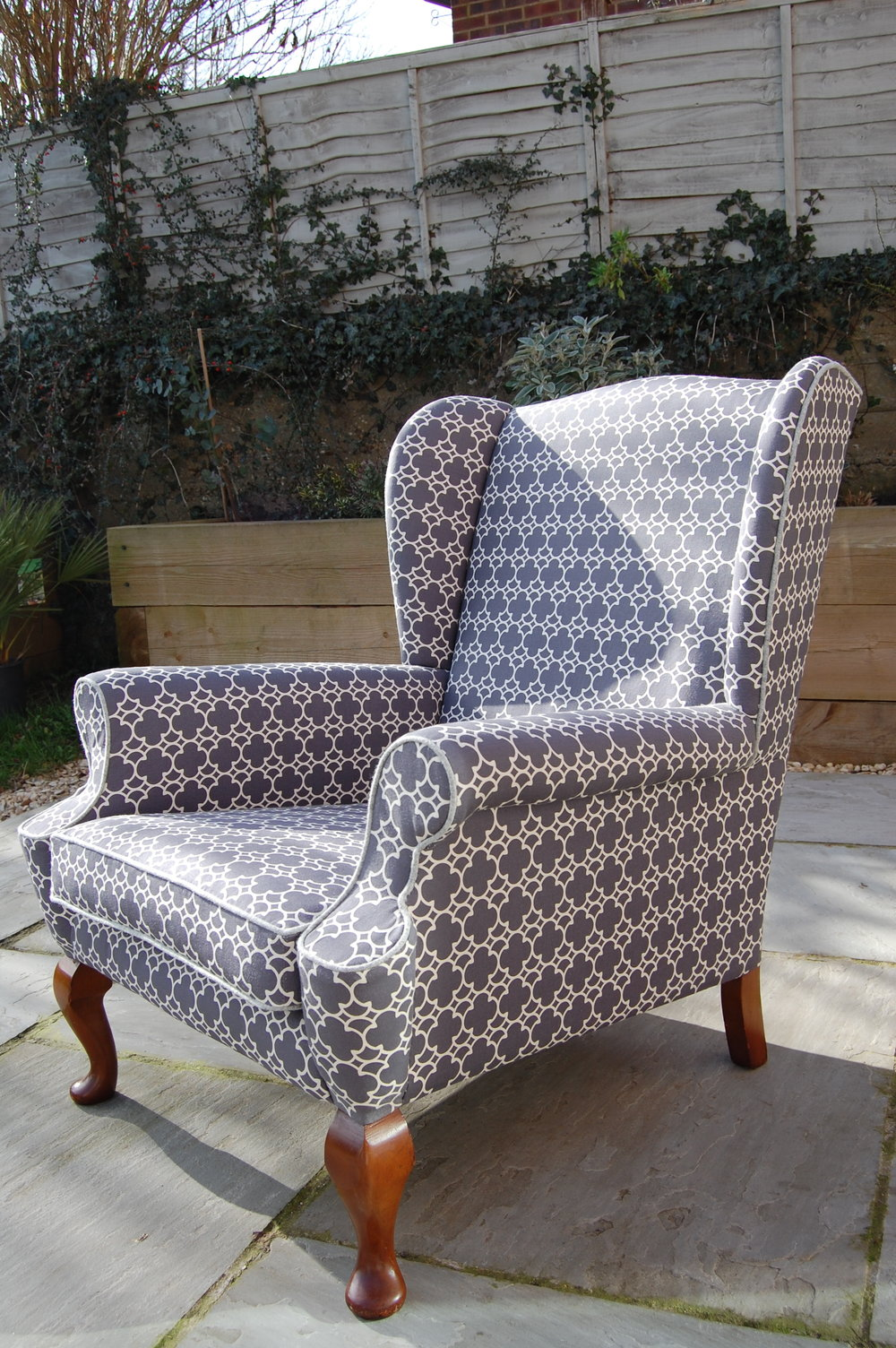 Grist & Twine Upholstery: Mid-century wingback armchair reupholstered in Korla geometric fabric