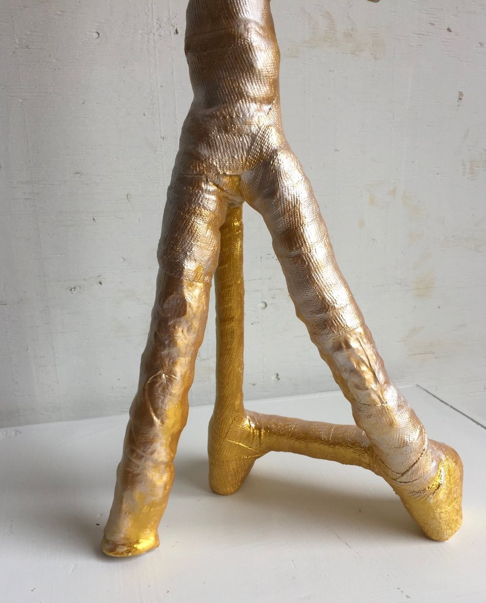 """'Shiny Shovel' Sculpture - Hand formed industrial clay, steel frame,fiberglass tape and gold paint.10 lbs. 12"""" wide x 36 """" high x 13"""" deep.  Contact the studio if your interested in the piece."""