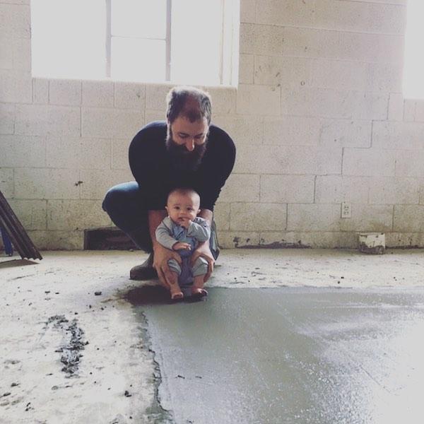 Christening the new cement. #arcanadistilling #newdistillery #stl