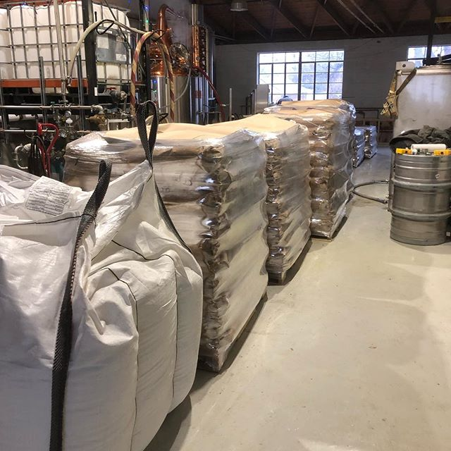 It's cold out - but we're here receiving our first three months of grain for production. About 10 barrels worth of grain right here ! We're very close to Distilling here - now just to collect a few more permits and button down some leaks.