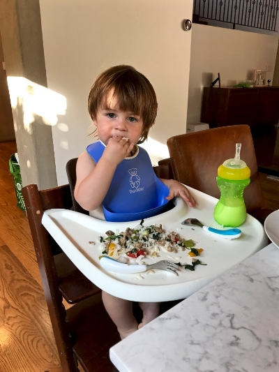 Theo enjoying a burrito bowl - ground turkey, rice, cheese, sauteed peppers and spinach
