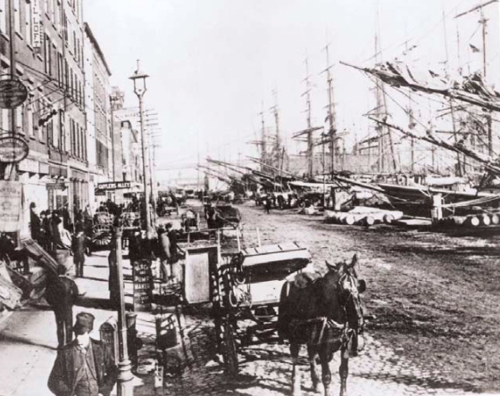 In the early 19th century, the Port of New York was booming, and South Street was known as the Street of Ships.