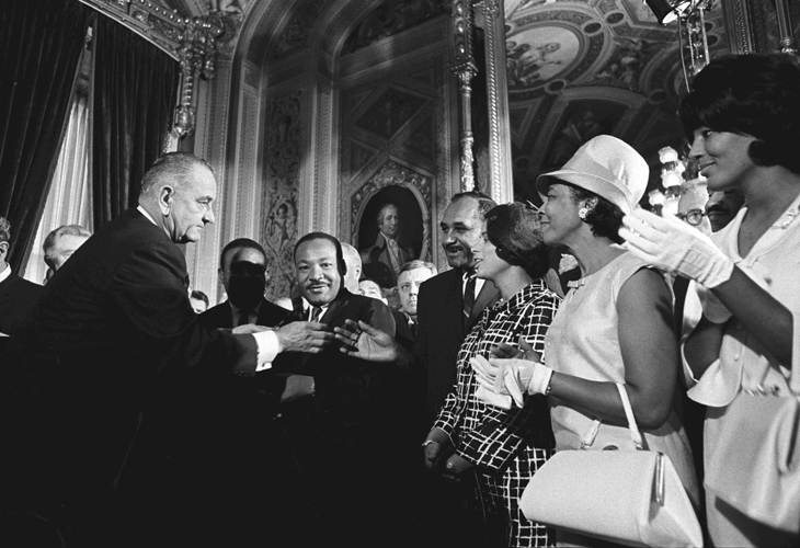 Lyndon B. Johnson, Martin Luther King, Jr., and others after the signing of the Voting Rights Act in 1965. Photo by Yoichi Okamoto.