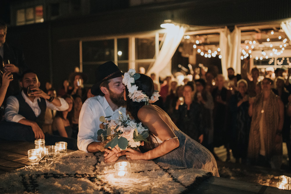 A bride and groom at their candlelit ceremony on Granville Island