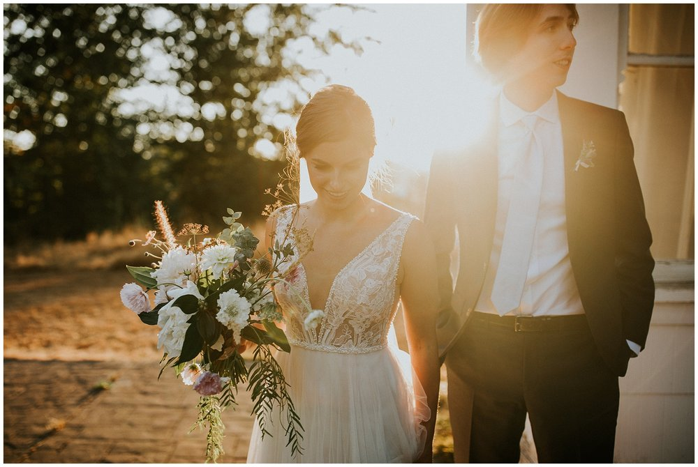 A golden hour wedding portrait by the farm house at Estate 248