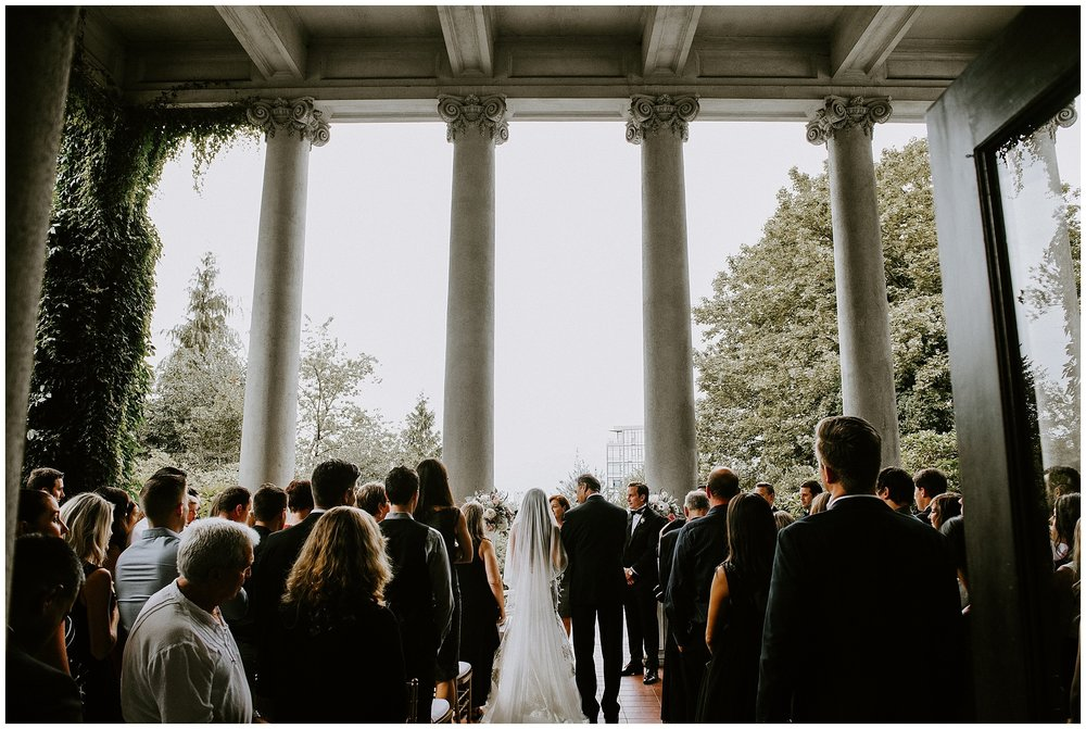 A ceremony photo of a wedding in the courtyard at Hycroft Manor