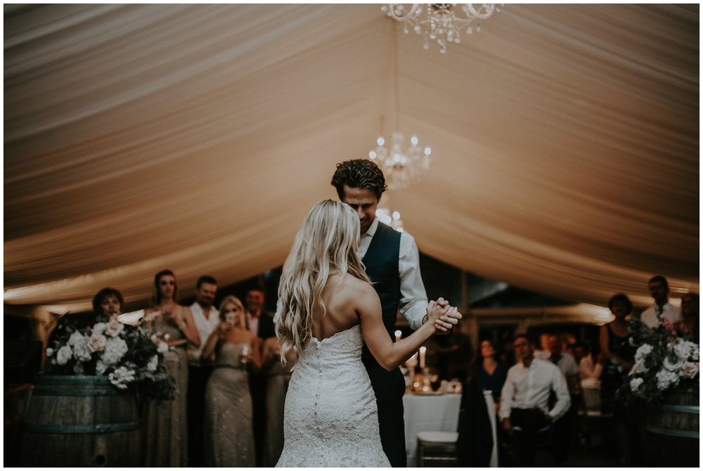 A bride and groom's first dance in the tent at the Hart House