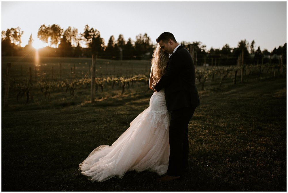 A bride and groom at sunset in the vineyard at Mount Lehman Winery