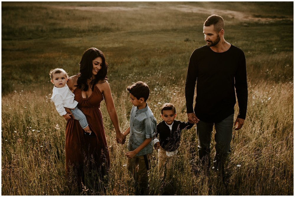 A candid and relaxed family photo during a summer session at Aldergrove Regional Park