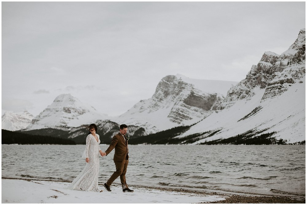 A bride and groom portrait from their wedding at Bow Lake in Jasper