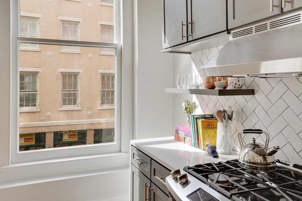 Kitchen corner with window and books on counter
