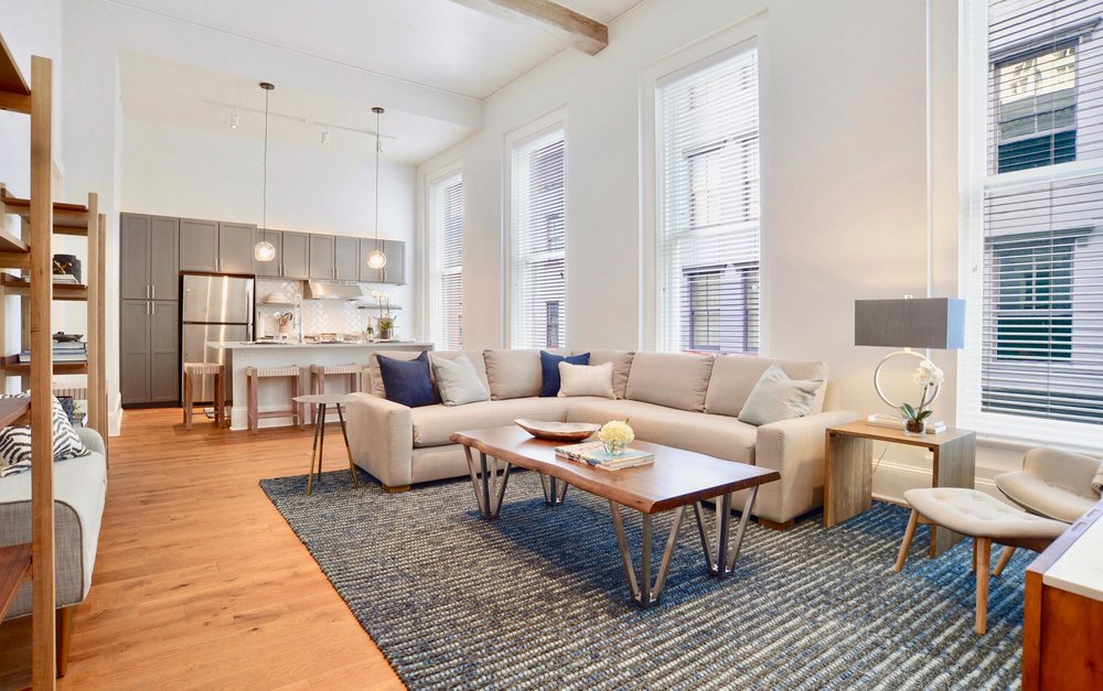 Large living space with ample seating and coffee table