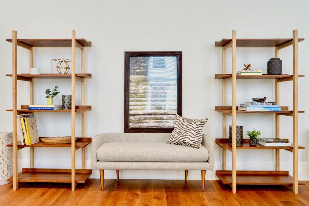 Two wooden book shelves with accessories