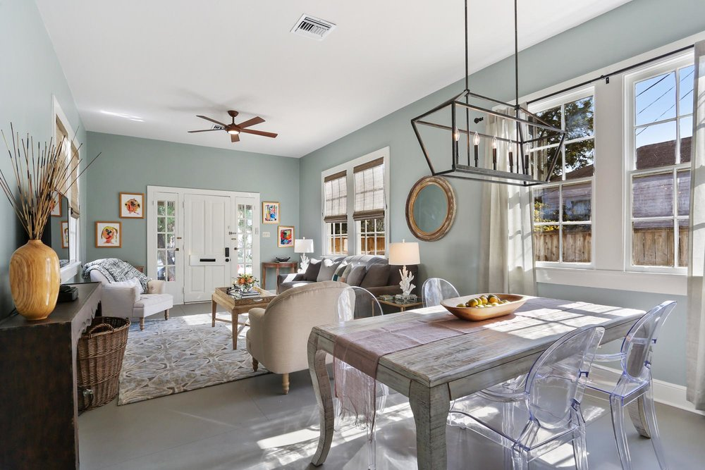 Open concept living room and dining room space with lots of seating
