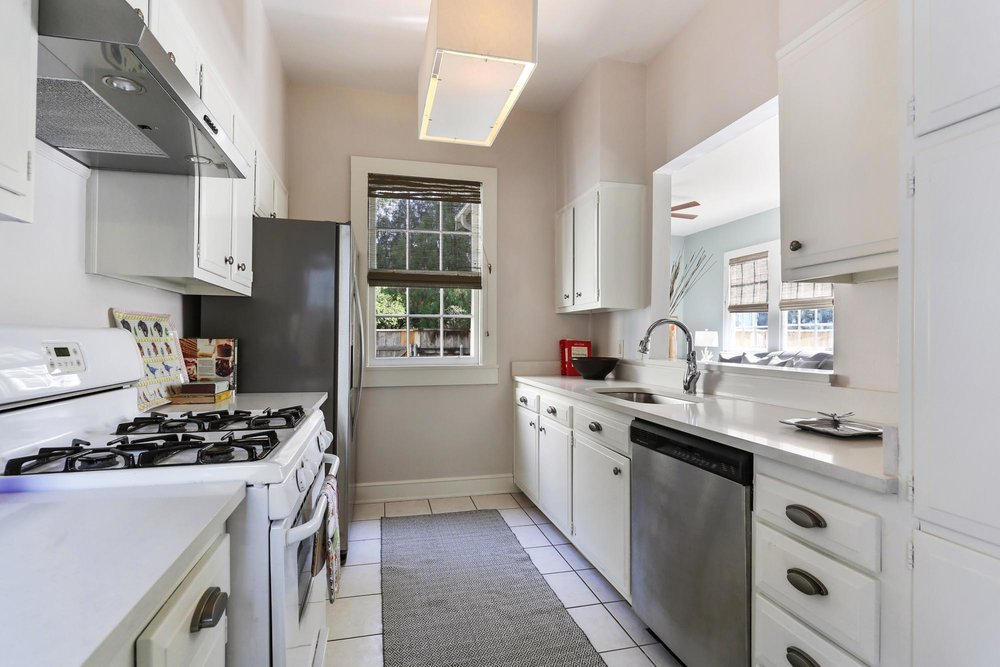 Functional kitchen space with white and grey color palette