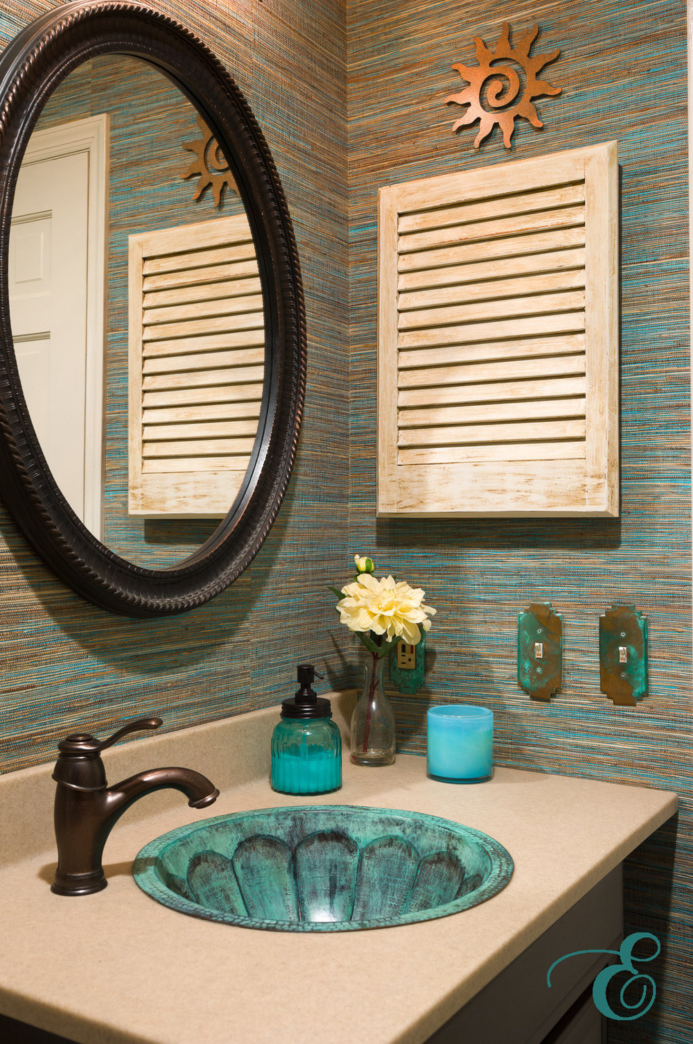 Southwestern powder room with grasscloth wallpaper and a custom sink