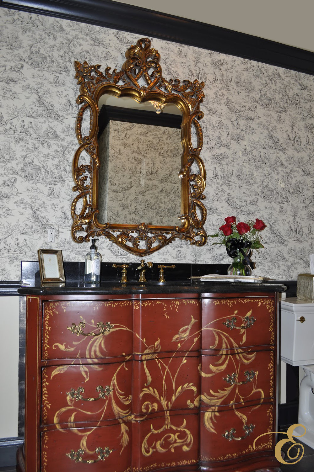 Our client wanted a traditional and luxurious powder room with toile wallpaper and accents in red, her favorite color