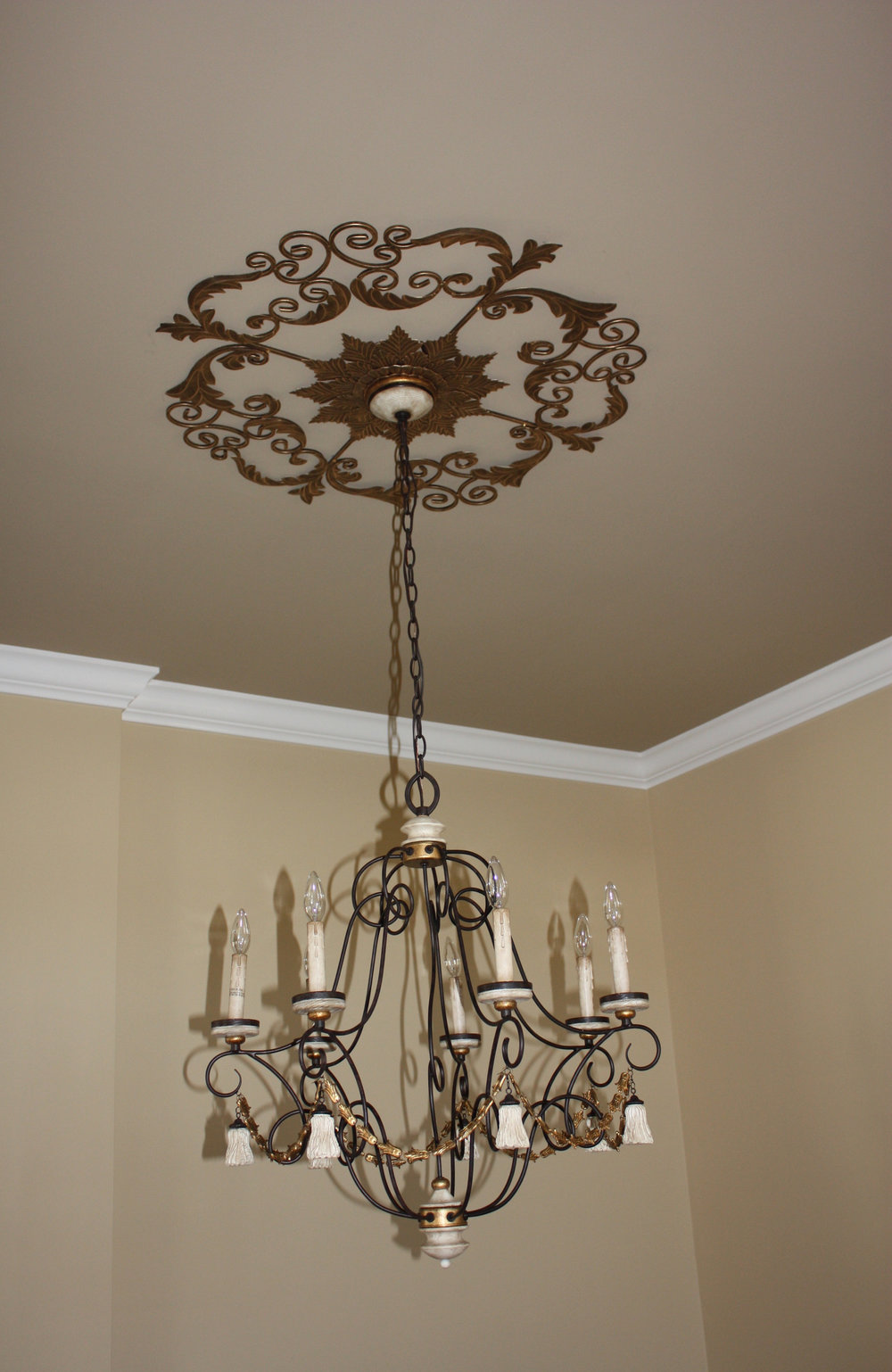 Custom details like this beautiful ceiling medallion elevate your space.