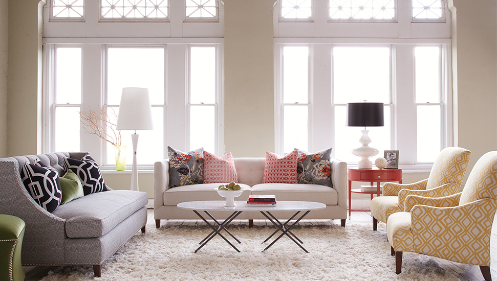 Custom hand-crafted upholstery by  Huntington House . We're huge fans of mixing patterns!