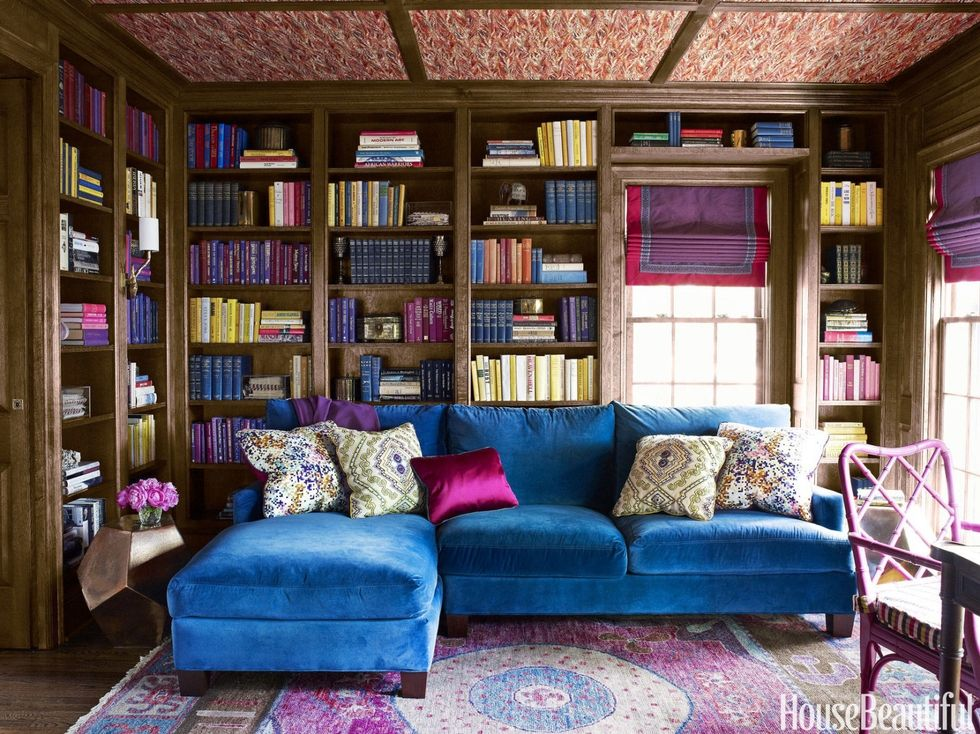 Bold library via  House Beautiful . Fun fact: Christine's first foray into interior design involved a wallpapered ceiling.