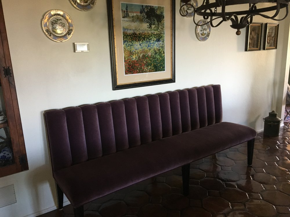 Gorgeous custom banquette brought to life by one of our workrooms.