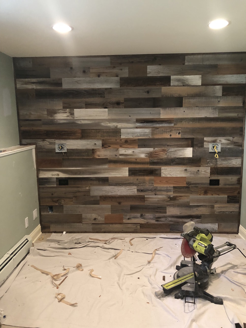 The accent wall is complete in this New City guest bedroom.
