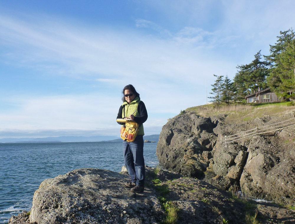 Mimi Fujino sketching on the beach, Pender Island, BC