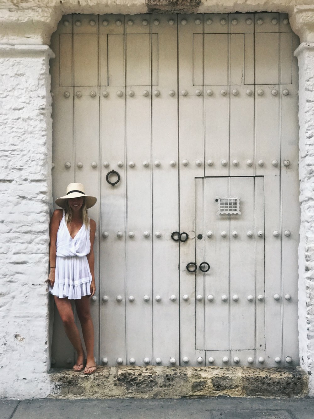 CITY OF DOORS |    If I didn't already have an obsession with doors when I arrived, I certainly left with one DRESS:    INDAH  ,  HAT:      JANESSA LEONE   ,   Shoes:  havaianas