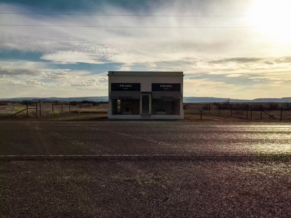 Prada Marfa, Est 2005. Medium: adobe bricks, glass, paint, aluminum, MDF and carpet