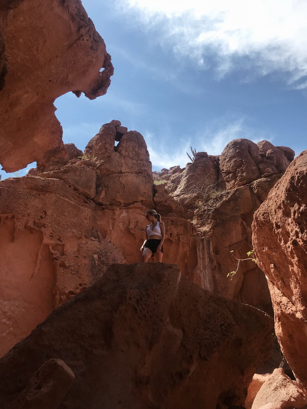 A short hike leads you to dramatic PINK AND red rock formations and caves.