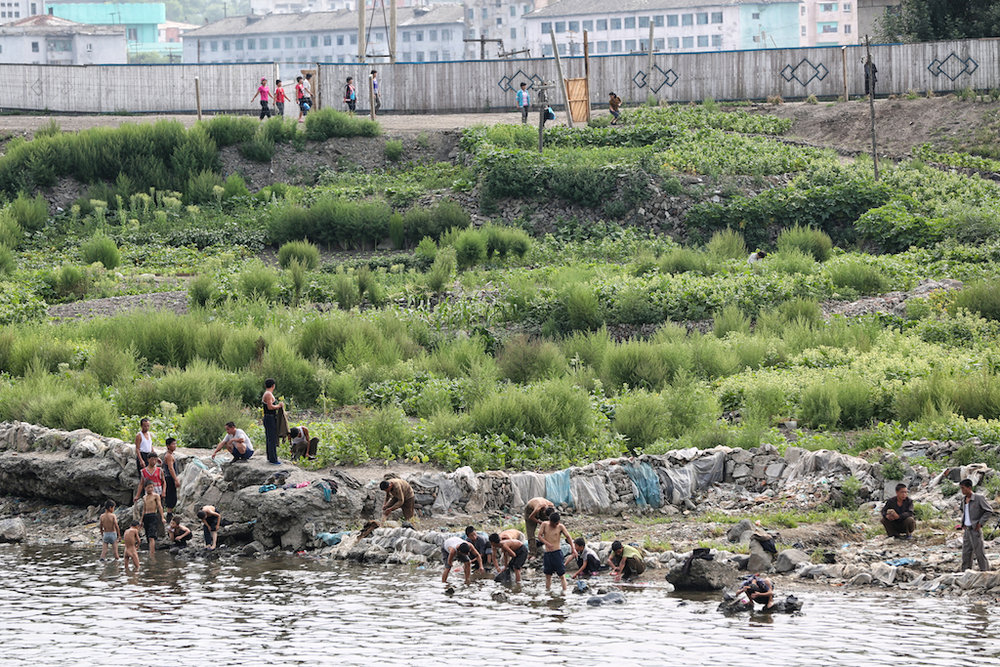 People of North Korea from the China side of the Yalu River, 2014.