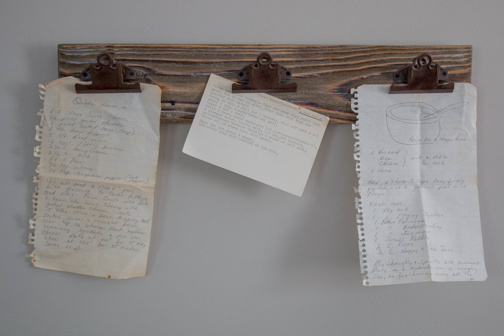 This play on a clipboard displays some of Patrick's grandmothers recipes, including one for a happy home pictured far right.