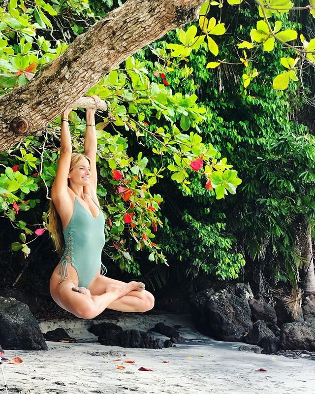 Sometimes all you can do is just hang on. 🤗🐒 🌺  Wearing @cobaltswim @lspaceswim 💫#lotus #yoga #costarica 📷👉🏼 @paging_kev