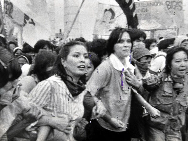 As a member of WOMB, Gomez (center) joined rallies with activists CB Garrucho (left) and Karina Constantino-David (Photo reproduction by Richard Reyes) courtesy of Inquirer.net